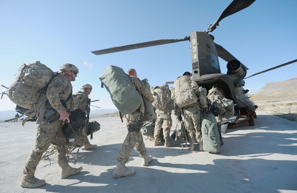 US soldiers boarding a Chinook helicopter in the Gardez district of Afghanistan's Paktia Province in 2011. USCENTCOM announced on 15 June that the Pentagon has already completed more than 50% of the military retrograde process in Afghanistan. (Ted Aljibe/AFP via Getty Images)