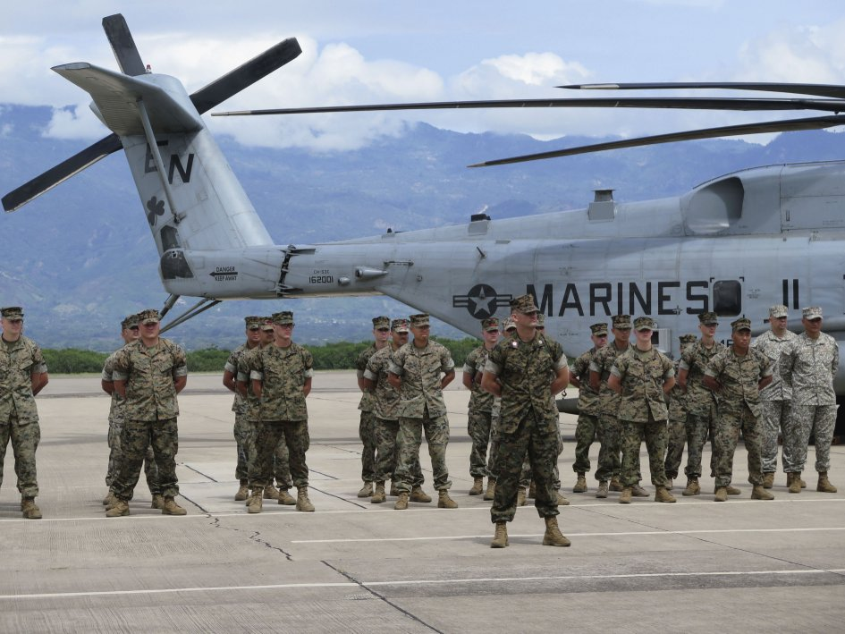 US Marines participate in the 21 June SPMAGTF-SC opening ceremony at Soto Cano Air Base outside of Comayagua, Honduras. Members of the task force are now in Colombia for a week of humanitarian assistance training. (Jane's/Ashley Roque)