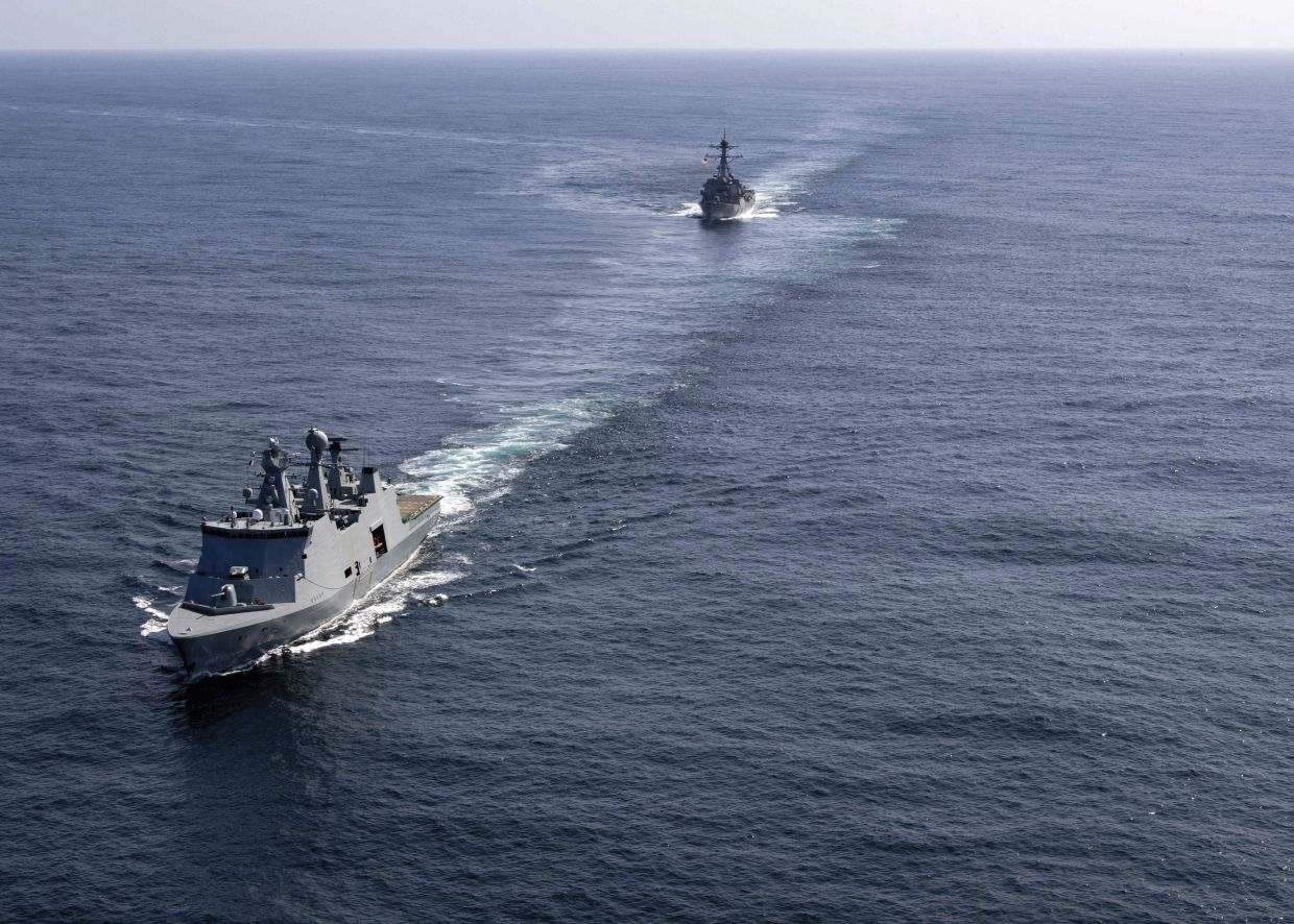 The Royal Danish Navy lead combat support ship HDMS         Absalon         and the US Navy's DDG 51 Arleigh Burke-class guided-missile frigate USS         Gravely         conduct a passing exercise (PASSEX) off Greenland in August 2019.         Absalon         was the second of Denmark's major warships to deploy to the country's Joint Arctic Command in 2019.        (US Navy)