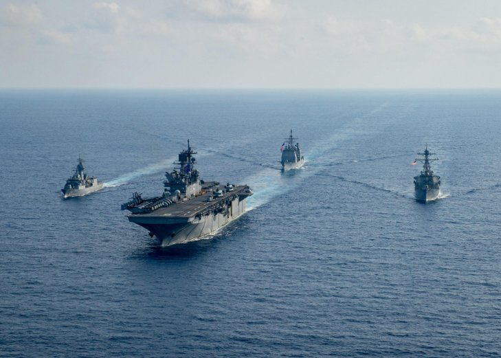 RAN guided-missile frigate HMAS          Parramatta          (FFH 154), left, sails with USN amphibious assault ship USS          America          (LHA 6), guided-missile cruiser USS          Bunker Hill          (CG 52), and guided-missile destroyer USS          Barry          (DDG 52) on 18 April as part of joint training activities in the South China Sea, a move that was criticised by Beijing.