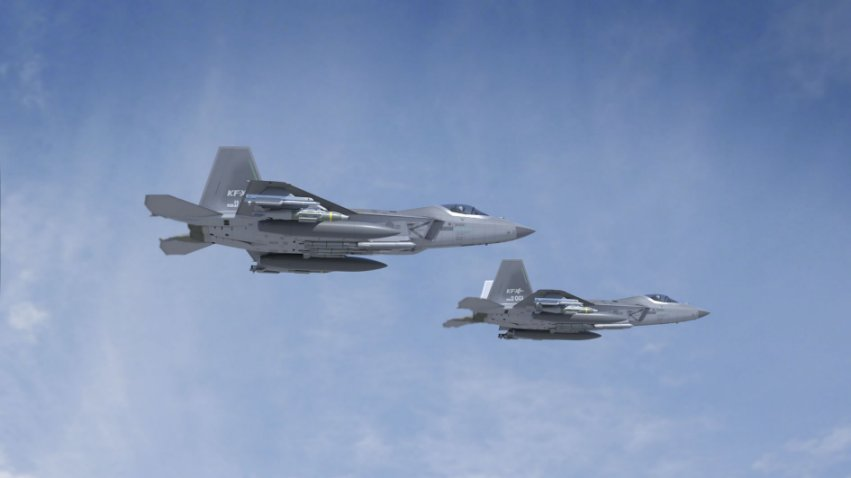 A computer-generated image showing two KF-X fighter aircraft equipped with Meteor BVRAAMs, forward-looking infrared pods, and Joint Direct Attack Munitions.