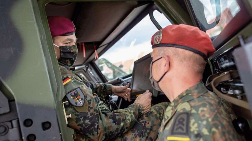 German Army chief Lieutenant General Alfons Mais (left) inspects the service's new BMS in an Eagle command vehicle during the introduction of the system in Frankenberg.