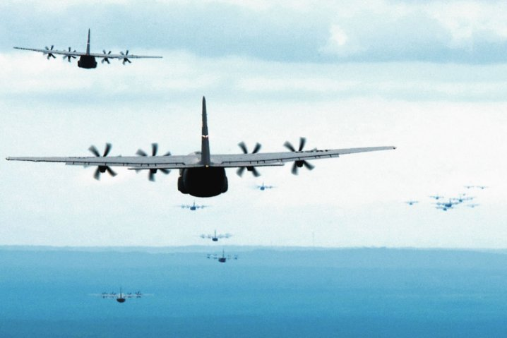 A formation of US Air Force C-130Js fly towards a drop zone during an exercise. Lockheed Martin has been awarded USD15 billion to cover work through to 2030, which follows an earlier 2016 award for USD10 billion to cover production through to 2016.  (US Air Force)