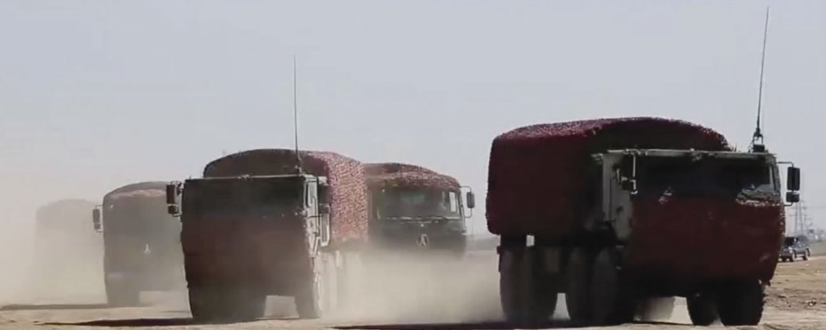A screengrab from CCTV 7 video footage released on 28 July showing new heavy-duty trucks (the two vehicles in the foreground) that have entered service with the PLA's Tibet Military District.  (CCTV 7)