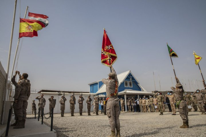 Spanish soldiers serving with the coalition lower their flag at the Besmayah Range Complex as they hand the facility over to the Iraqi Army on 25 July. CJTF-OIR attributed this and other base transfers this year to the success Iraqi forces have had against the Islamic State. (Combined Joint Task Force - Operation Inherent Resolve)