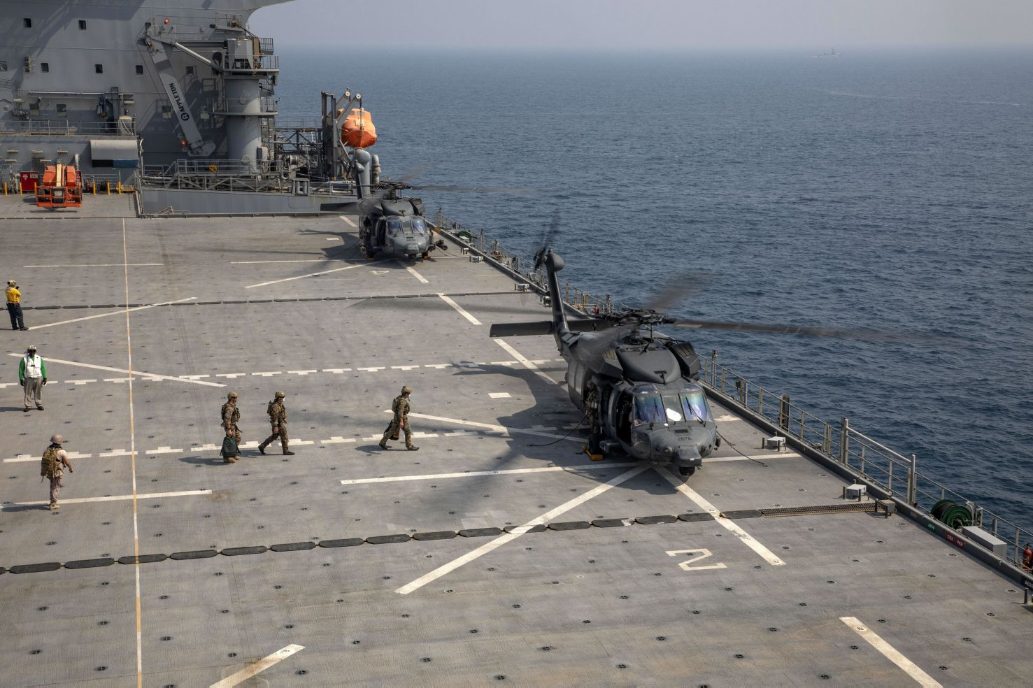US personnel board an Emirati UH-60L Black Hawk that landed on USS          Lewis B Puller          during a live-fire exercise in the Gulf on 11 August.        (US Marine Corps    )