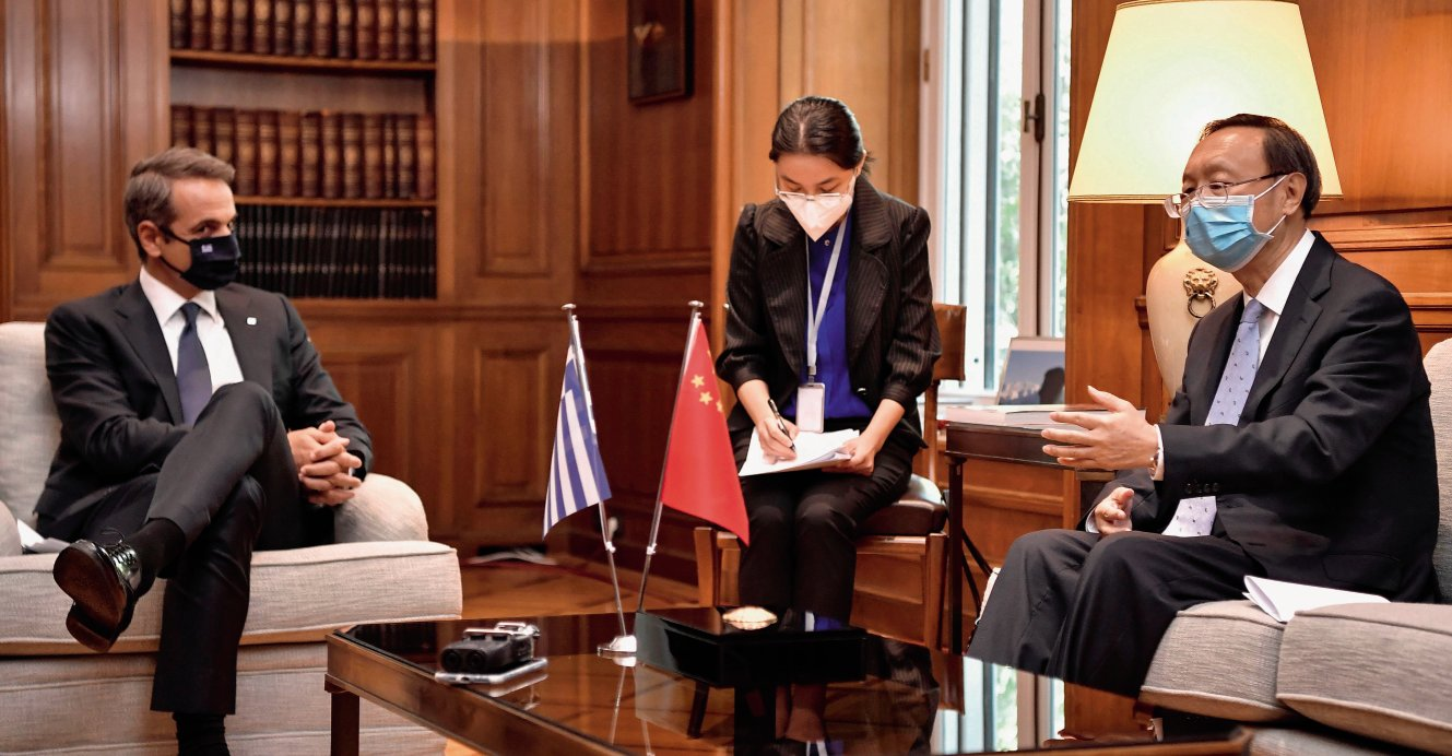 Director of the Central Foreign Affairs Commission of the Chinese Communist Party Yang Jiechi (right) meets Greek Prime Minister Kyriakos Mitsotakis (left) in Athens on 4 September 2020. In Europe, China's Belt and Road Initiative has found particular uptake in the countries of the Balkan region. (Louisa Gouliamaki/AFP via Getty Images)