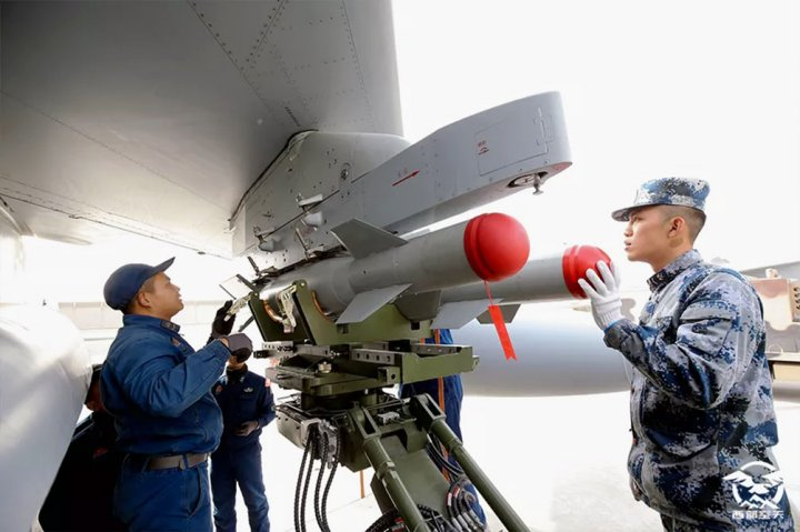 An image published on 17 September on the WeChat account of the Western Theatre Command of the PLAAF showing what appear to be two GB 100 precision-guided bombs being loaded onto a JH-7A fighter-bomber. (PLAAF)