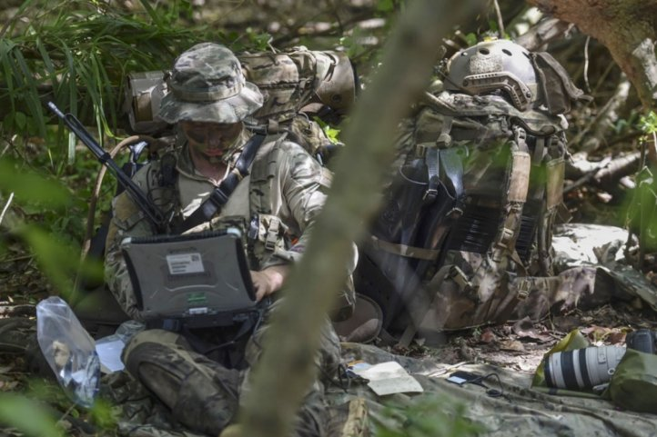 A US Air Force Special Operations Weather Technician sends intelligence during a 31 October 2017 field exercise. Pentagon officials are seeking new spectrum bandwidth solutions for 5G communications on civilian and military mobile networks. (US Department of Defense )