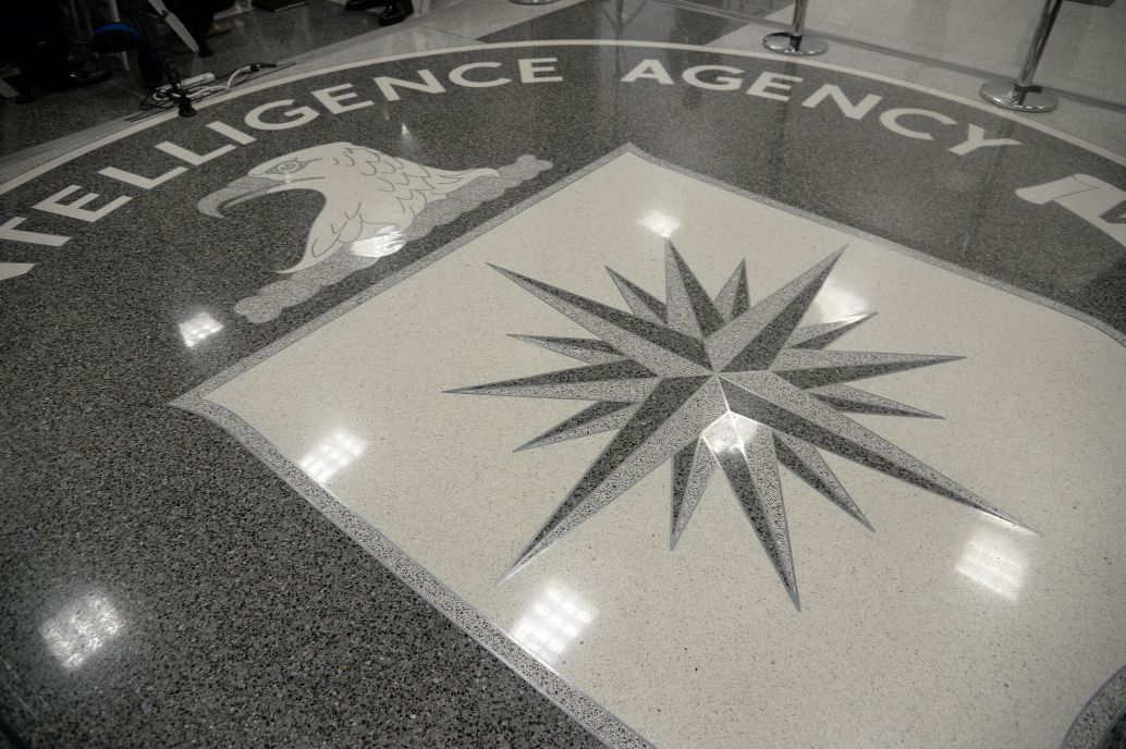 The shield of the CIA  at the agency's headquarters in Langley, Virginia. During his first official visit to a government agency on 21 January 2017, US President Donald Trump addressed CIA staff, although the executive's relations with the intelligence community rapidly deteriorated. (Olivier Doulier/Pool/Getty Images)