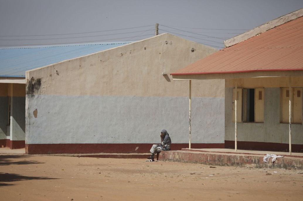 A parent sits outside the Government Science Secondary School in Kankara in Nigeria's northwestern state of Katsina, where gunmen kidnapped more than 300 schoolboys on 11 December 2020. (Kola Sulaimon/contributor/AFP via Getty Images)