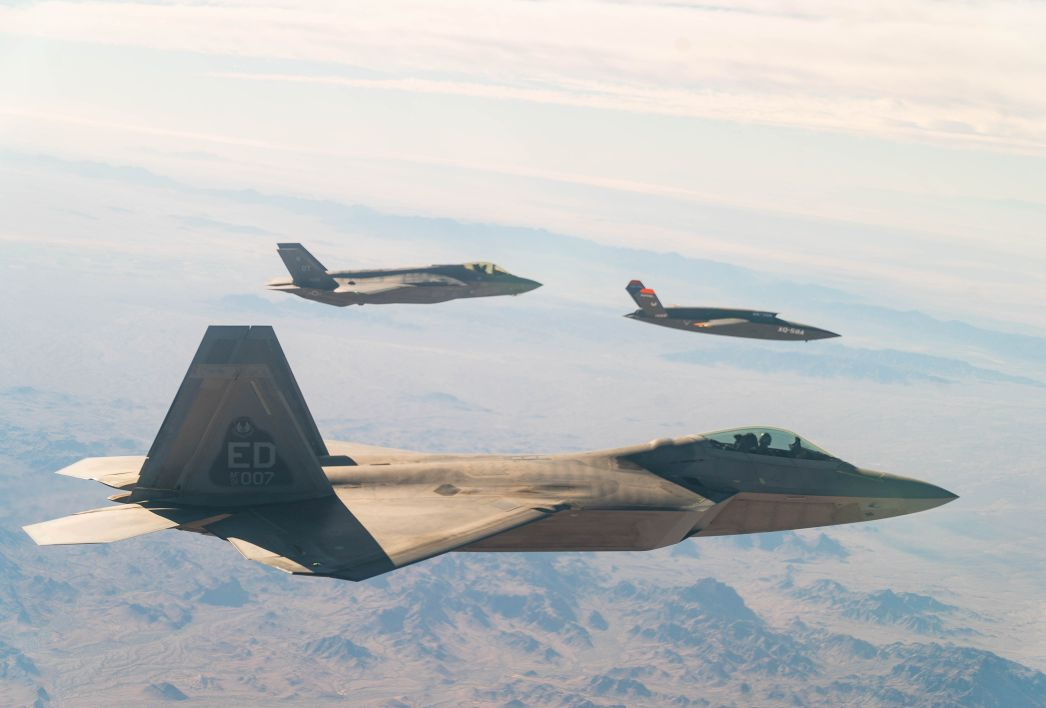 A US. Air Force F-22 Raptor and F-35A Lightning II fly in formation with the XQ-58A Valkyrie UAV over the U.S. Army Yuma Proving Ground testing range in Arizona, during a series of gatewayONE 'fifth generation' connectivity tests on 9 December. (US Air Force)