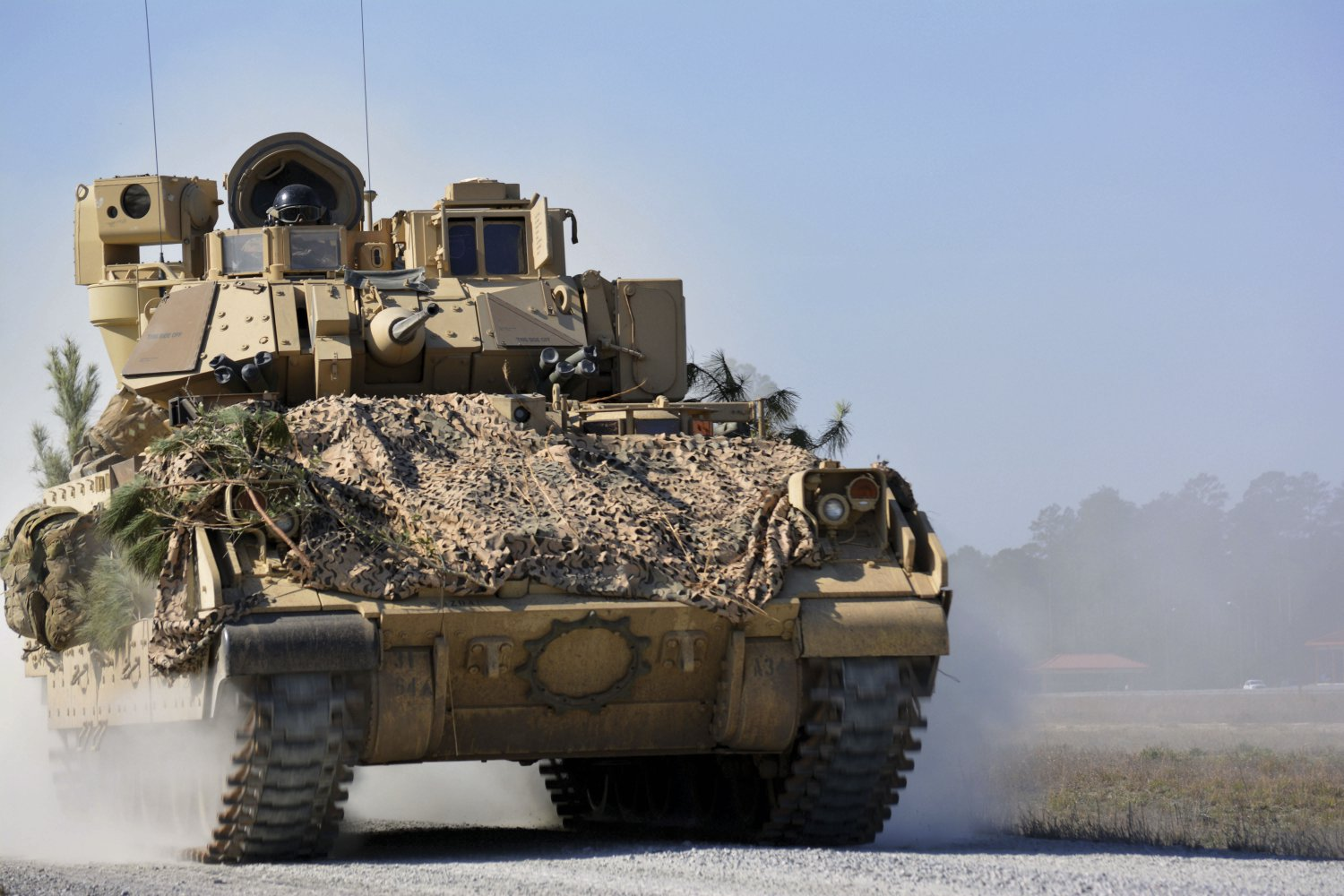An M2A3 Bradley Fighting Vehicle from 1st Battalion, 64th Armor Regiment, manoeuvres during a company combined-arms live-fire exercise at Fort Stewart, Georgia, in February 2017. The US Army has released its RFP for the revamped Bradley replacement effort. (US Army)