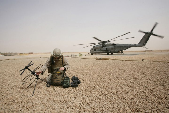 A US Marine Corps field radio operator from the 26th Marine Expeditionary Unit sets up satellite communication at Camp Korean Village, Iraq in 2008. (US Department of Defense )