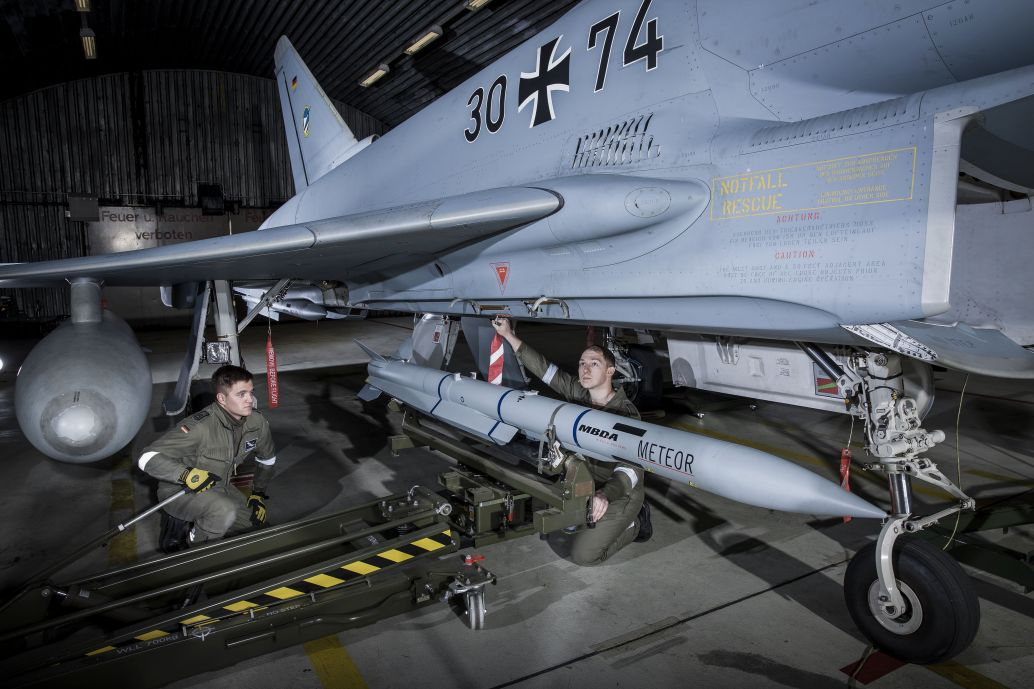 Luftwaffe ground crew load a Meteor BVRAAM aboard a Eurofighter combat aircraft. The service has now begun fielding the missile with the introduction of the P2Eb software on the aircraft. (MBDA)